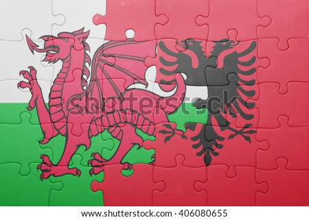 puzzle with the national flag of wales and albania . concept