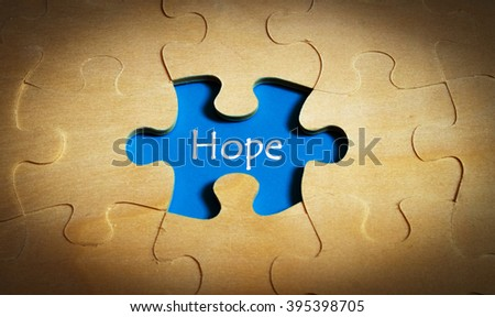 Puzzle with word hope - stock photo