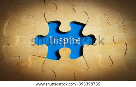Puzzle with word inspire - stock photo
