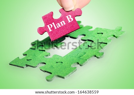 Puzzle word Plan B on green background - stock photo