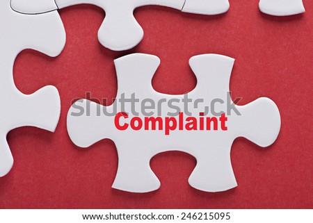 Puzzle written word Complaint - stock photo