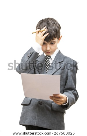 puzzled boy in a jacket with a sheet of paper holding head - stock photo