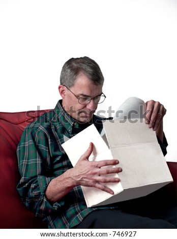 Puzzled man opening package