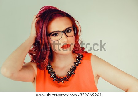 Puzzled woman. Portrait close up head shot of beautiful young female girl thinking , scratching head looking at you isolated green background. Human face expressions emotions feelings body language - stock photo