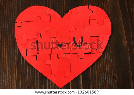 Puzzles in form of heart with words I - stock photo