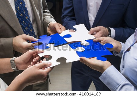 Puzzles in the hands of businessmen