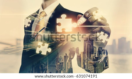 Puzzles with double exposure of businessman and big city