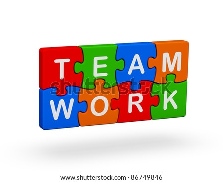 Puzzles with the words of team and work - stock photo