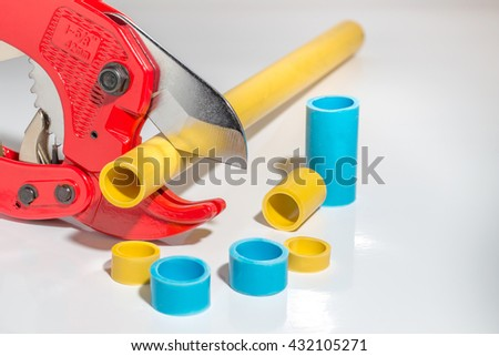 Pvc pipe cutter on white - stock photo