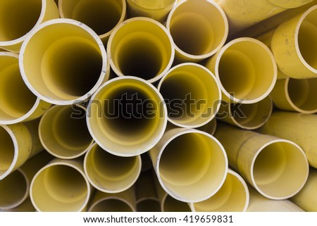 PVC pipes for electric conduit (yellow)  - stock photo