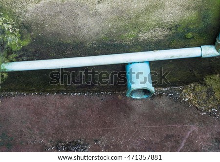 PVC water pipe sewer selective focus in ditch