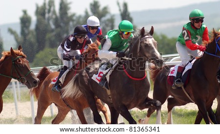 PYATIGORSK, RUSSIA - JULY 17:Jockeys(L - R) Imran Mardanov,Ilgiz Saitgaleev,Timur Guseinov and Imran Pshukov race for the prize of Asuana hippodrome on July 17,2011 in Pyatigorsk, Caucasus, Russia.