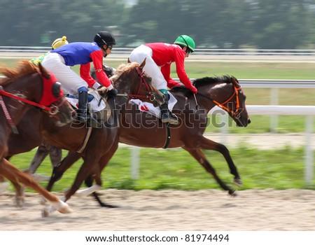 PYATIGORSK, RUSSIA - JULY 31:Jockeys(L - R) Shamil Guseinov and Pavel Stepakin race for the prize of Tarashi  on July 31,2011 in Pyatigorsk, Caucasus, Russia. - stock photo
