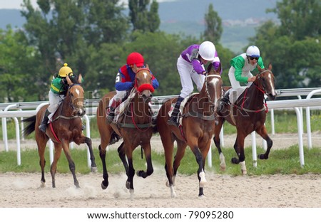 PYATIGORSK, RUSSIA - JUNE12: (L - R) Jockeys Imran Mardanov,Aid Kardanov,Rinat Hamidullin and Adel Aituganov.Horse race for the prize of the Probni on June 12, 2011 in Pyatigorsk, Caucasus, Russia.