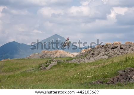 PYATIGORSK, RUSSIA - JUNE 06, 2009: Motorcyclist in the jump on the competition. - stock photo