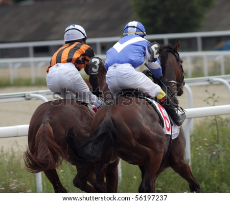 "PYATIGORSK, RUSSIA - JUNE 27: The race for the prize of the ""Nasima"" on June 27, 2010 in Pyatigorsk Caucasus, Russia.Jockey Aituganov and Hatkov."