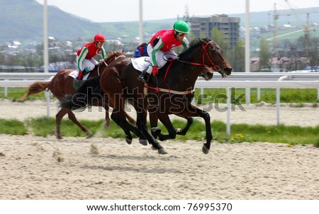 PYATIGORSK, RUSSIA - MAY 8: Jockey Ulubaev cross the finish line first in a horse race on May 8, 2011 in Pyatigorsk, Caucasus, Russia. He races for the prize of Winner Day.