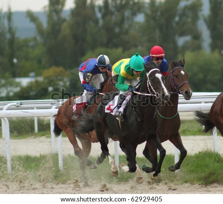 "PYATIGORSK, RUSSIA - OCTOBER 10: The race for the prize of the ""Master-trainer Dobrodeev"";The jockey Guseinov,Dohtov and Tihonov; October 10, 2010 in Pyatigorsk; Caucasus; Russia."