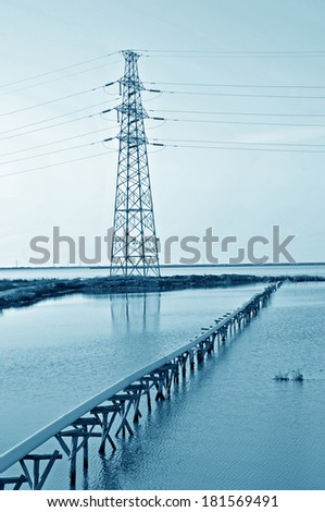Pylon and simple reflection in the water pipe equipment  - stock photo