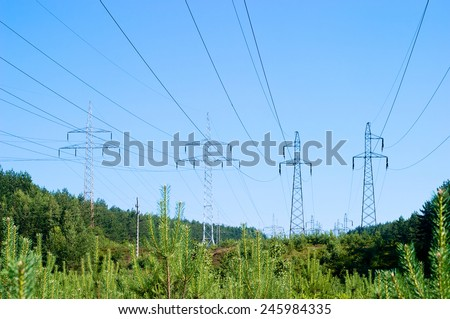 Pylon and transmission power line - stock photo