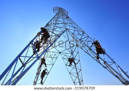 Pylon construction workers - stock photo