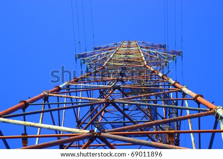 pylon of High Voltage Transmission Lines against the blue sky - stock photo