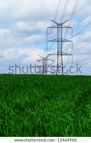 pylons against a blue sky - stock photo