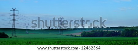 pylons against a blue sky, panorama - stock photo