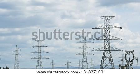 pylons under an overcast sky - stock photo