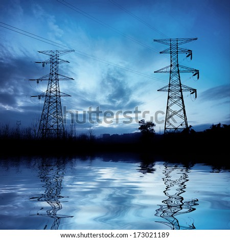 Pylons under the night sky background - stock photo