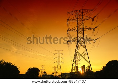 pylons with golden sunset colour on the background - stock photo