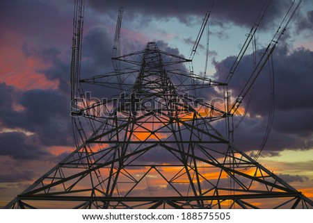 pylons with vivid sunset background - stock photo