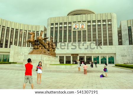 "Pyongyang, North Korea - August 2012: The tourists taking the photos in landmark building ""Mangyongdae Children's Palace"", Pyongyang city, the capital of North Korea (DPRK)"