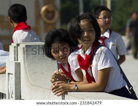 PYONGYANG, NORTH KOREA - CIRCA APRIL 2012: kids in the park near Kim Il-sung Mausoleum (Kumsusan Memorial Palace) during the celebrating centenary birth of President Kim Il Sung.  - stock photo
