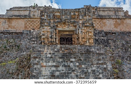 Pyramid against the blue cloudy sky in the ancient city Uxmal - Yucatan, Mexico - stock photo