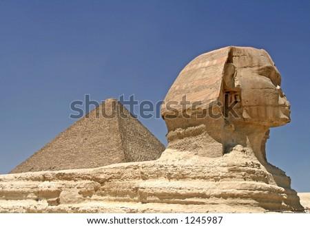 Pyramid and Sphinx at Giza, Cairo - stock photo