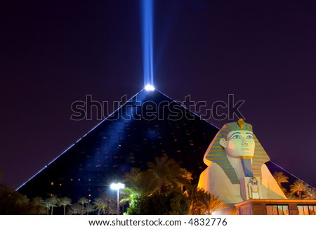 Pyramid and sphinx at night in Las Vegas - stock photo
