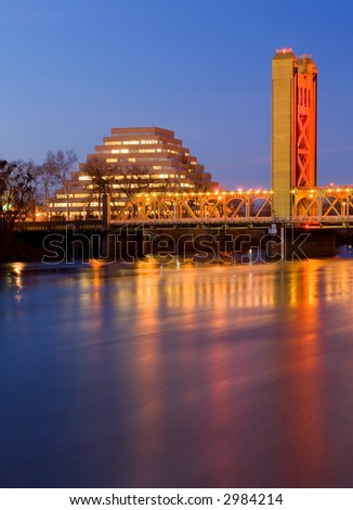 Pyramid and Tower Bridge in Sacramento at night - stock photo