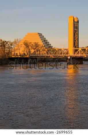 Pyramid and Tower Bridge in Sacramento at sunset - stock photo
