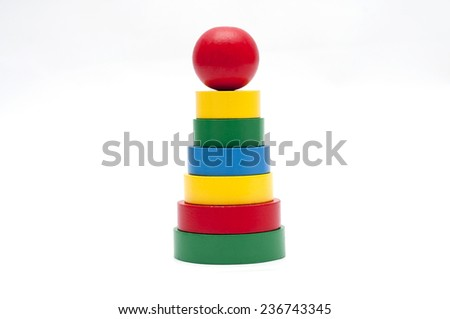 Pyramid build from colored wooden rings  - stock photo