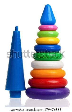 Pyramid build from colorful plastic rings, isolated on white background. - stock photo