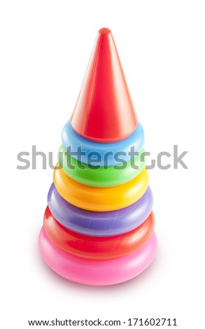 Pyramid build from colorful plastic rings, isolated on white background. Toy for babies and toddlers
