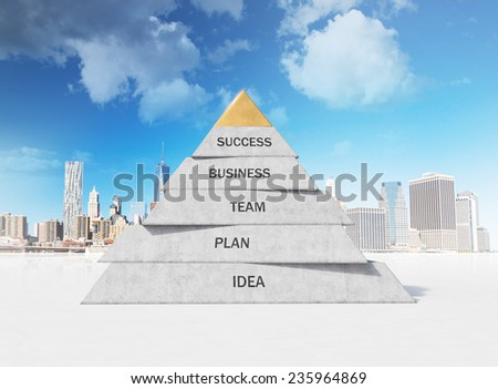 pyramid composed of business concepts on city background - stock photo
