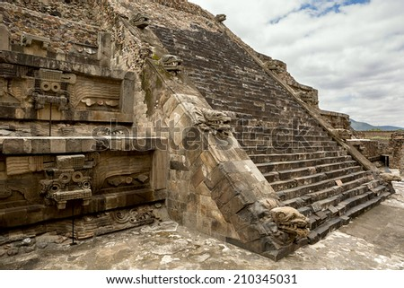 pyramid details in Teotihuacan decorated with stone statues  - stock photo