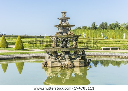 Pyramid Fountain (sculptor Francois Girardon) in gardens of famous Versailles palace. Palace of Versailles was a royal chateau. It was added to UNESCO list of World Heritage Sites. Paris, France. - stock photo