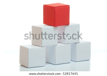 Pyramid from boxes with red box on the top - stock photo