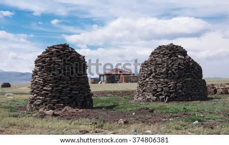 Pyramid from manure is a traditional way to procure fuel for the winter - stock photo
