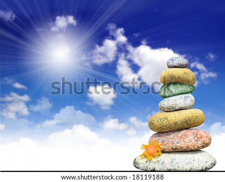 Pyramid from stones on heavenly background - stock photo