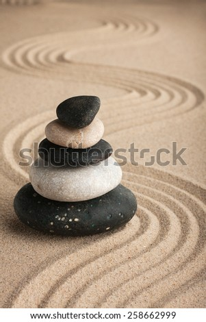 Pyramid made of  stones standing on the sand,as a background