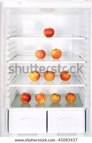 Pyramid of apples in the refrigerator - stock photo